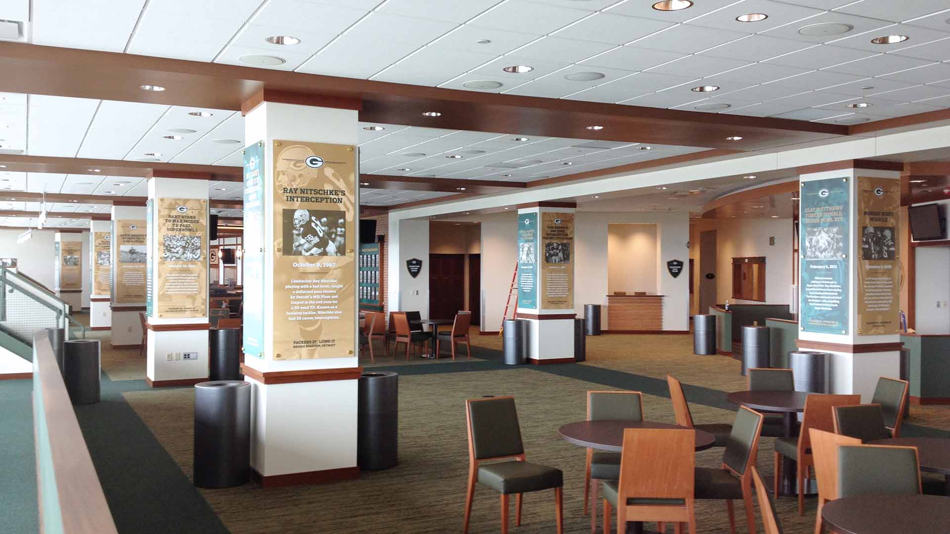 Club house area with graphic panels on columns