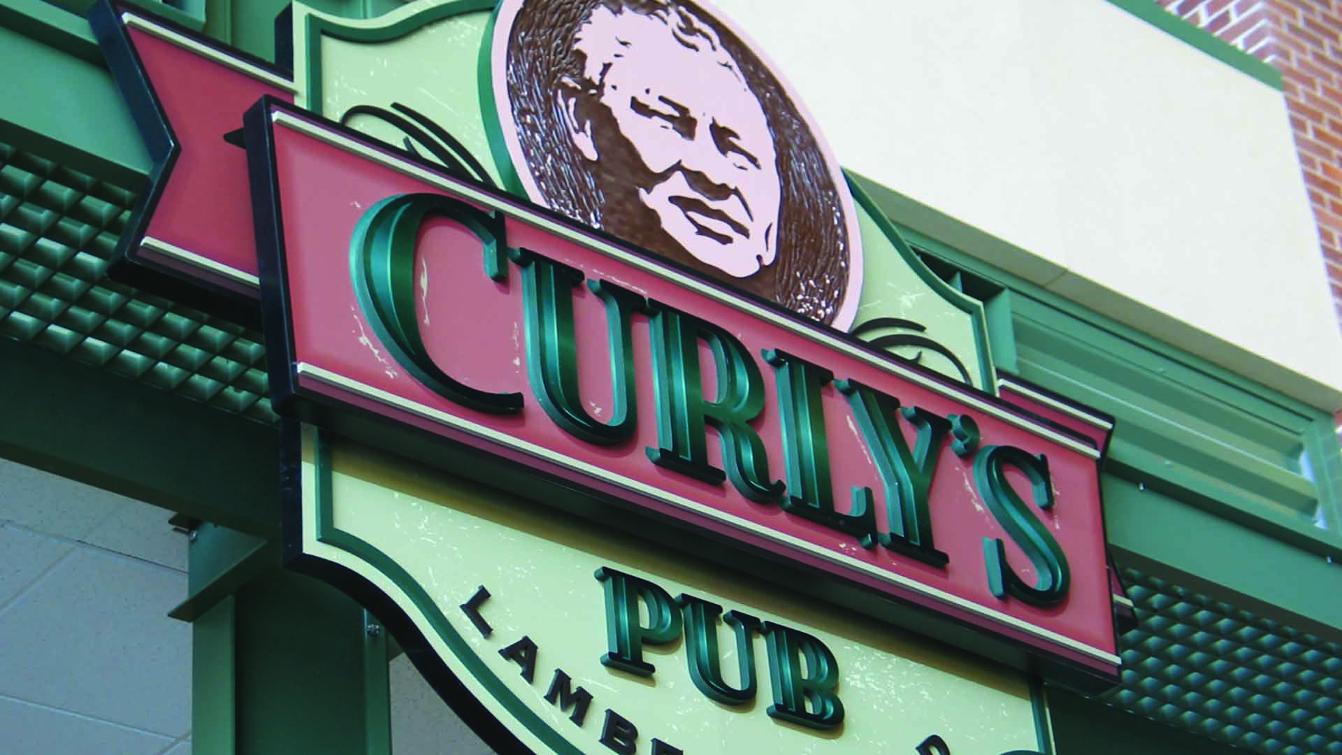 Curly's Pub dimensional sign.
