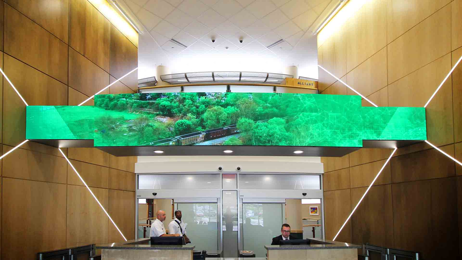 Lobby with LED media screen on soffit above reception desk