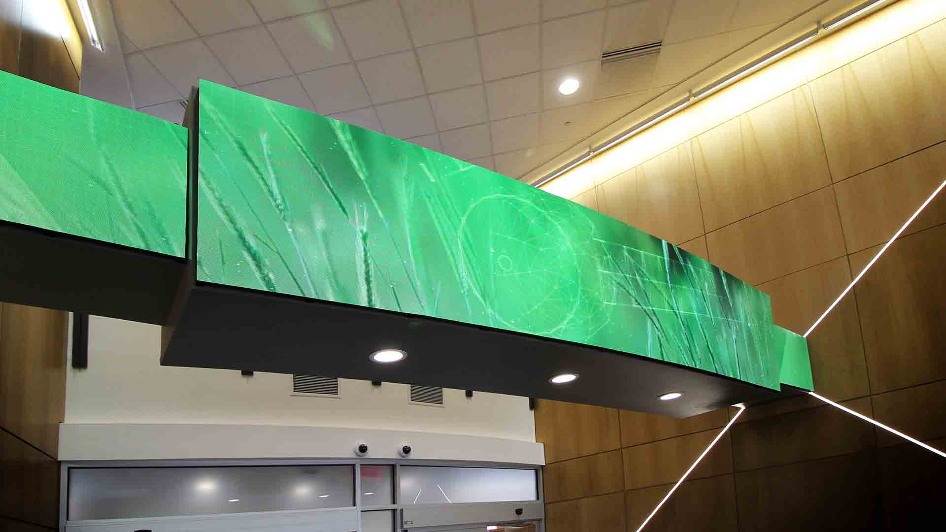 Close up view of LED media screen on soffit above reception desk in lobby