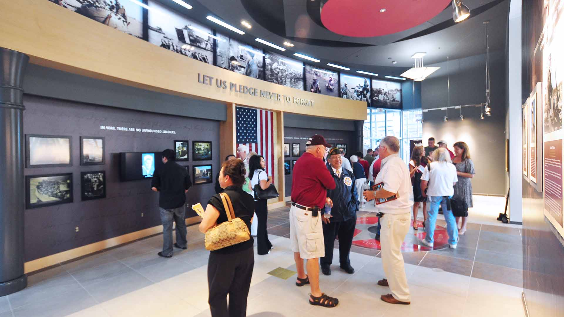 Veteran's Memorial museum exhibit space with media, photos, and artifacts