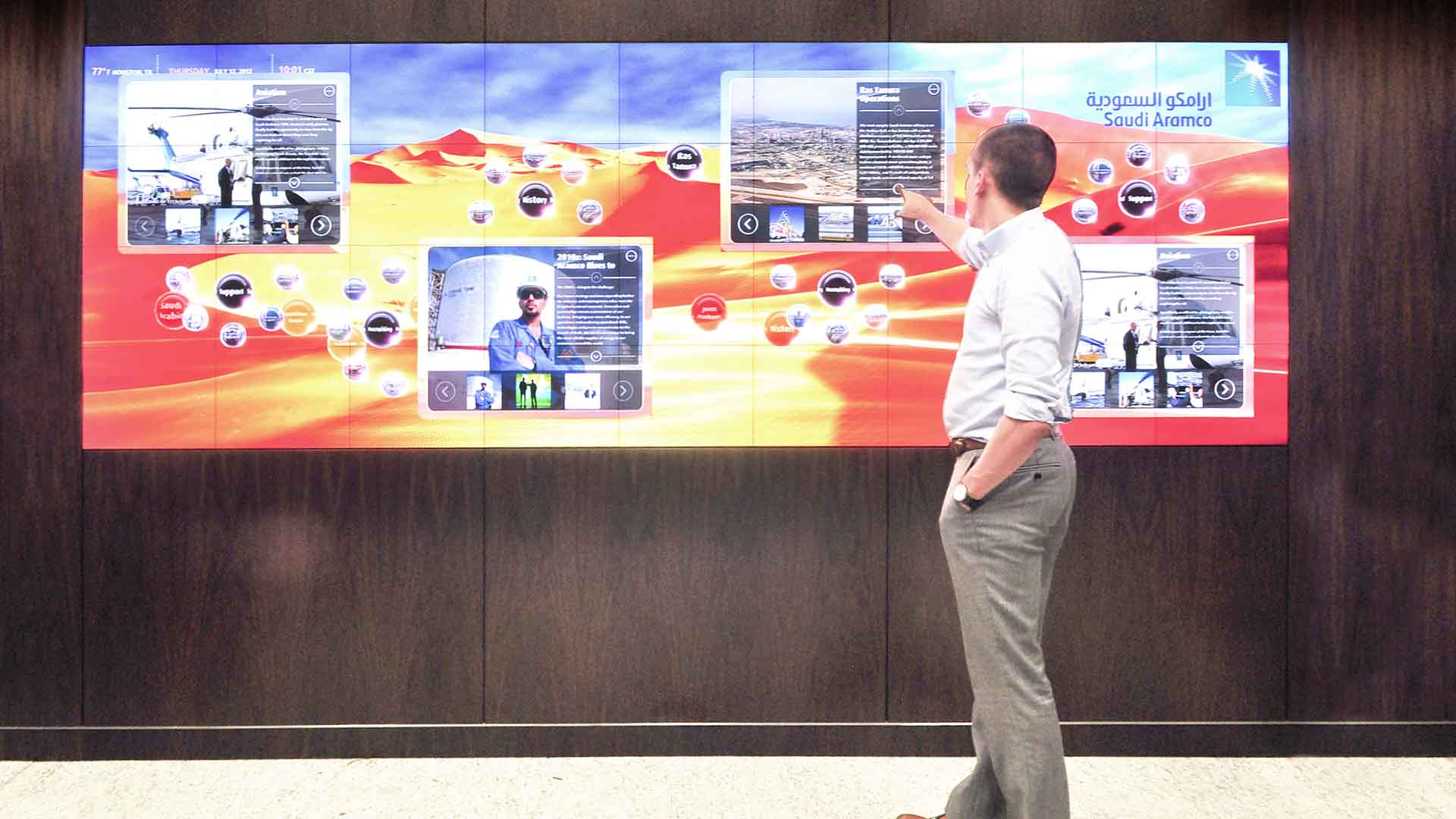 Developer showing how content management system works on interactive media exhibit