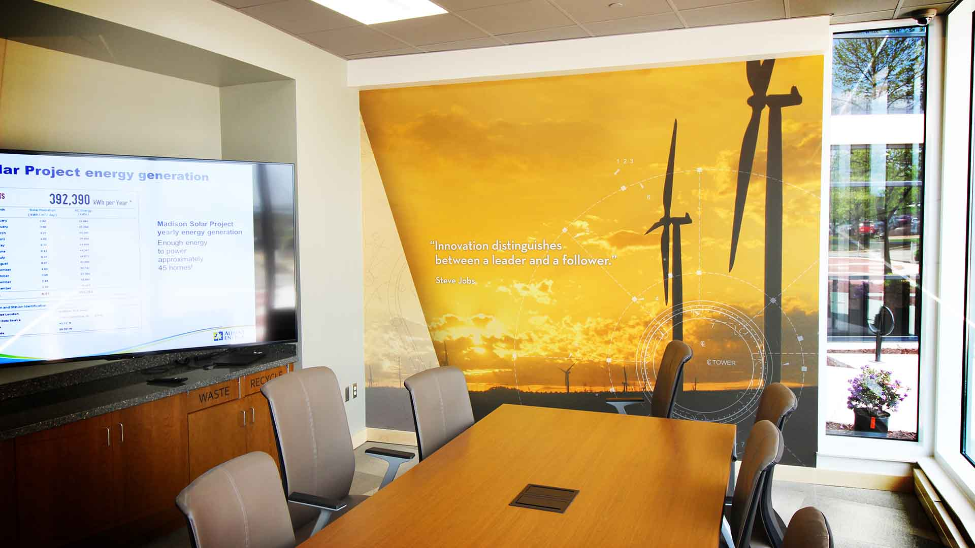 Conference Room with wall mural graphic of wind turbines and quote