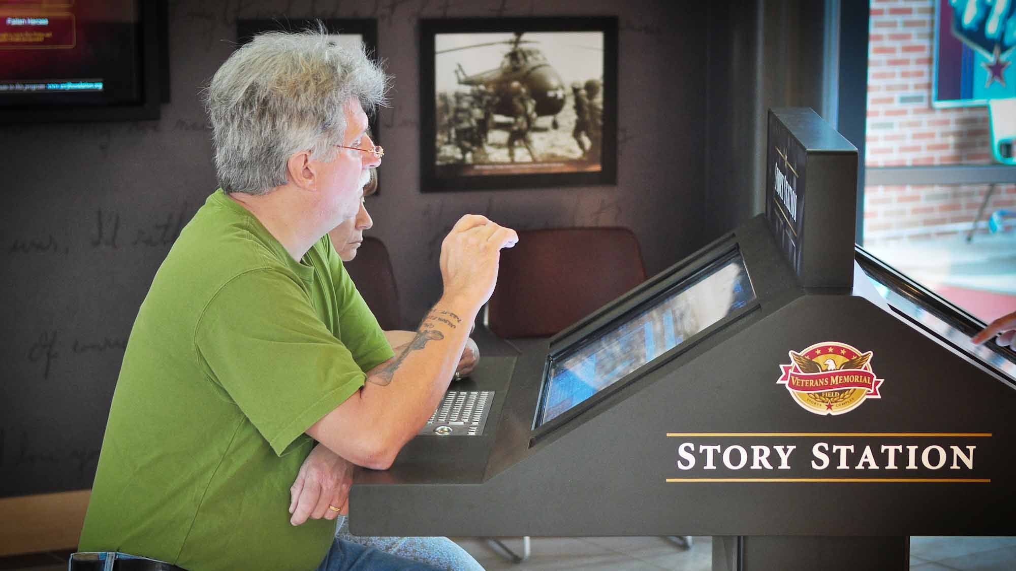 Couple interacting with story station media exhibit