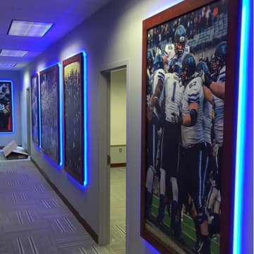 Hallway of backlit portraits