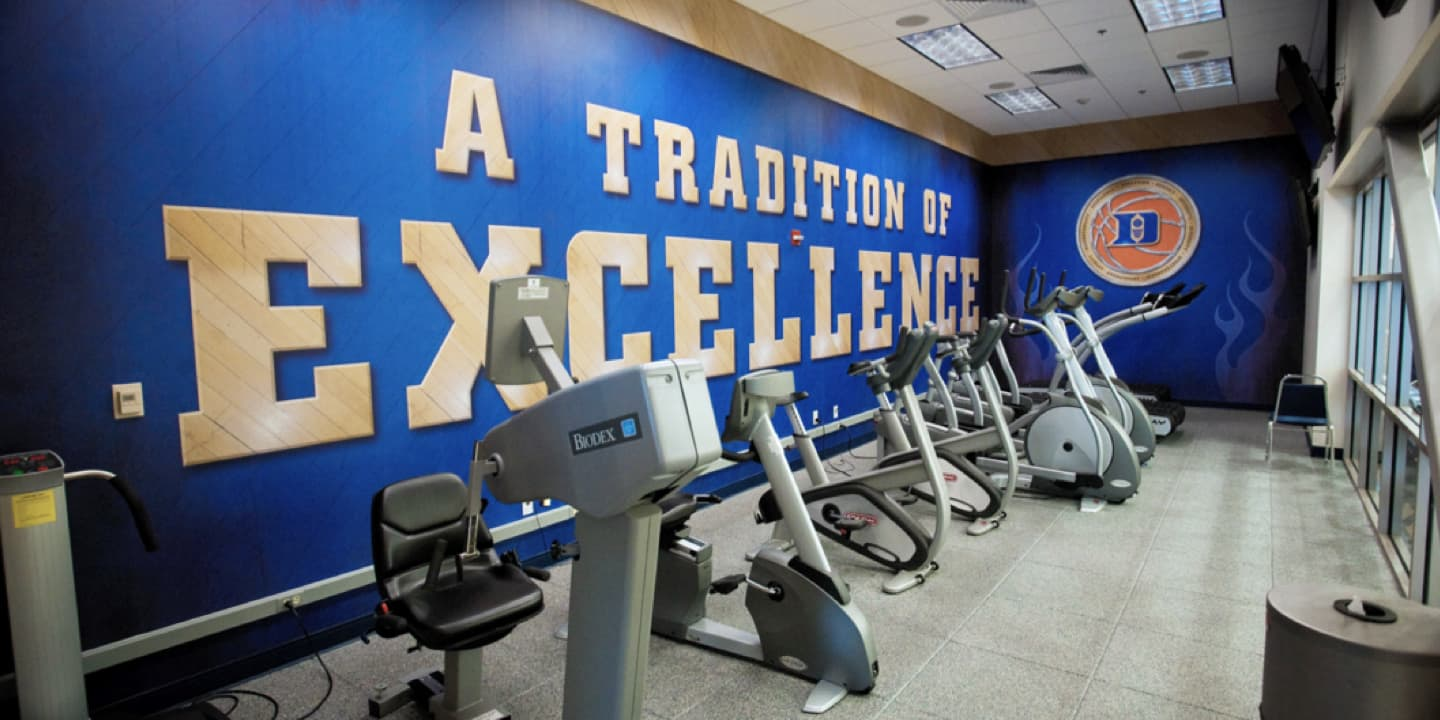 Gym with A Tradition of Excellence mural