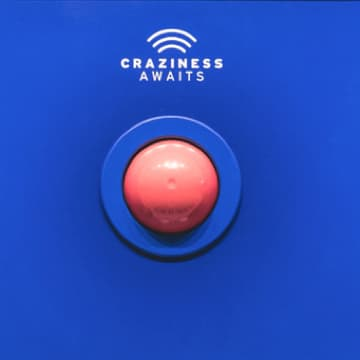 "Button labeled ""Craziness Awaits"""